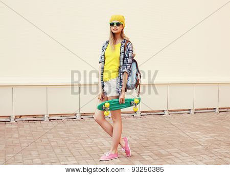 Fashion Summer Hipster Cool Woman In Sunglasses And Colorful Clothes With Skateboard Outdoors
