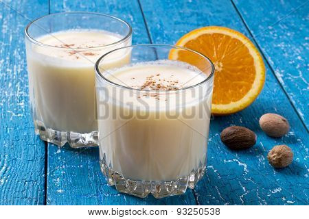 Milk Cocktail With Orange, Ice Cream And Nutmeg