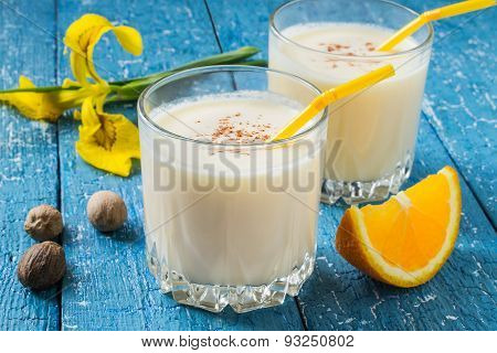 Milk And Orange Cocktail With Nutmeg