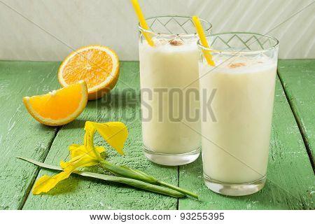 Fresh Homemade Milkshake With Ice Cream, Orange Juice And Nutmeg