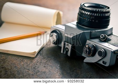 the old analogue camera and notepad