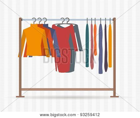 Clothes racks with dresses on hangers.