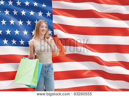 A Happy Young Woman With The Colourful Shopping Bags From The Fancy Shops. Us Flag Background.