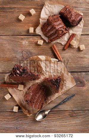 Tasty chocolate cake on wooden table