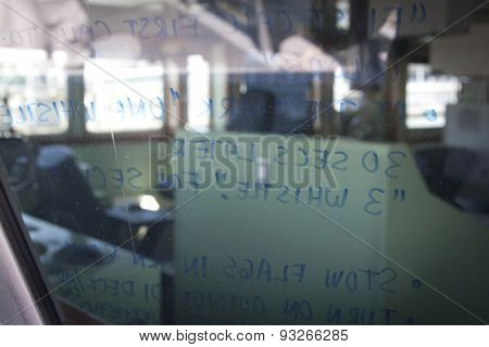 NEW YORK - MAY 22 2015: Reminders written in marker on the window of a US Naval Academy Yard Patrol Craft used for at-sea training and research by students, moored at Pier 86 for Fleet Week NY 2015.