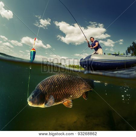 Split shot of the fisherman with rod in the boat and underwater view of the big fish (Carp of the family of Cyprinidae)