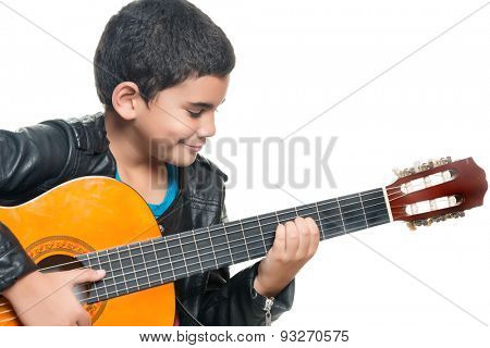 Cute hispanic boy playing an acoustic guitar isolated on a white background