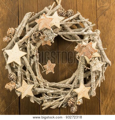 Christmas Decoration With Twigs, Brown Pine Cone And Wooden Stars On Wooden Background