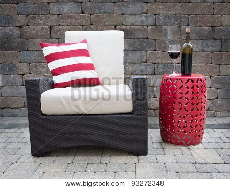 Red Wine On Table Next To Chair On Upscale Patio