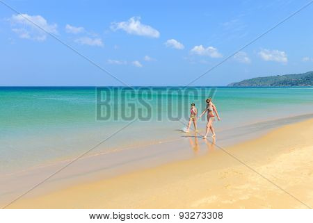 Couple Of People On Beautiful Beach