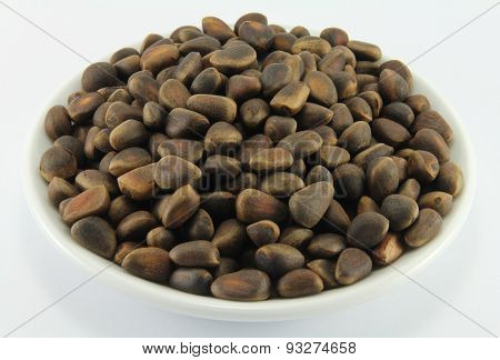 Pine nuts on a white porcelain dish