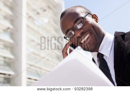 Businessman Have Phone Conversation On Office Building Background