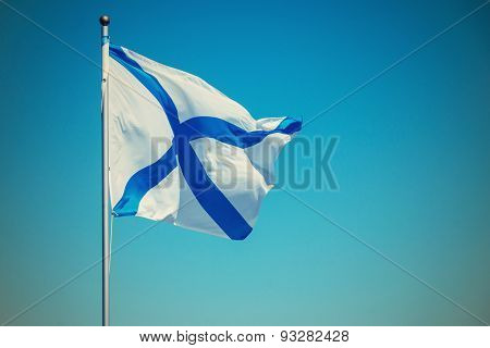 White Flag With Blue Cross Flies On A Flagstaff