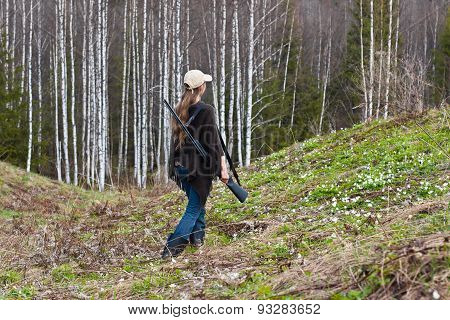 Woman Hunter Shooting On The Forest Edge