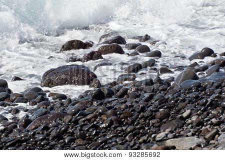 Round stones on coast