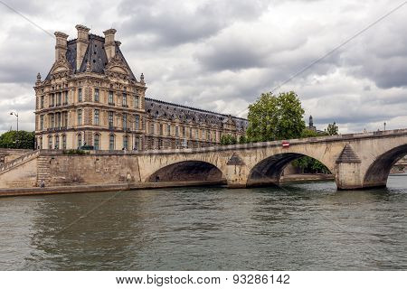 Pont Royal Over Seine In Paris With View At The Louvre