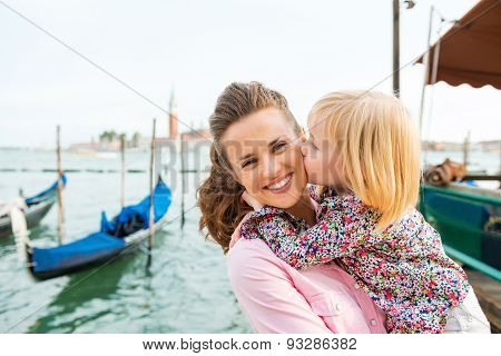 Child Kissing Happy Mother In Venice