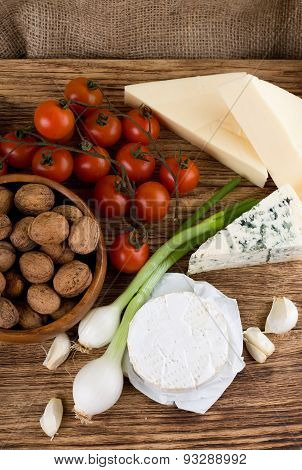 Top View On Several Kinds Of Cheese And Vegetable
