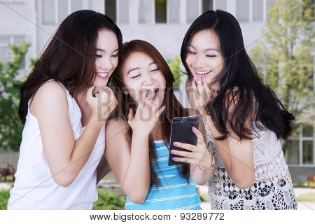 Attractive Girls Laughing At Schoolyard
