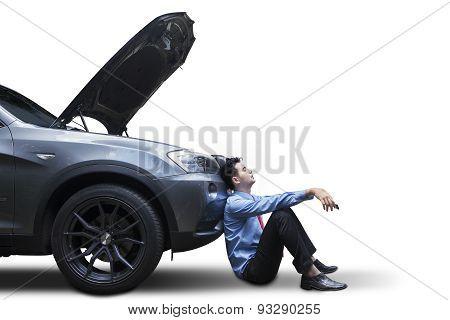 Businessman Sitting Near The Broken Car