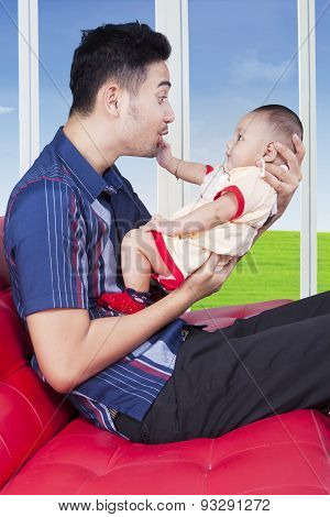 Cute Baby Play With Father On Sofa