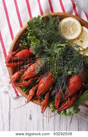 Crayfish With Herbs And Lemon On A Plate Closeup. Vertical Top View