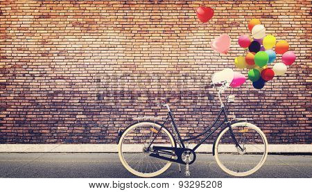 bicycle vintage with colorful balloon