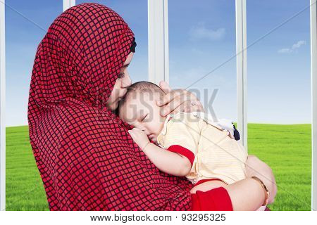 Muslim Mother And Her Baby Boy At Home