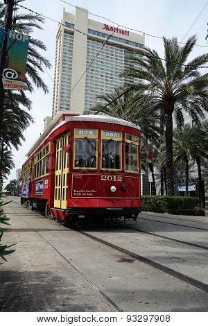 New Orleans, LA, USA - 3-21-2014: New Orleans Canal St. Street Car With The Marriott Hotel In The Ba