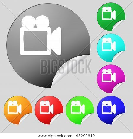 Camcorder Icon Sign. Set Of Eight Multi Colored Round Buttons, Stickers. Vector