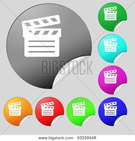 Cinema Clapper Icon Sign. Set Of Eight Multi Colored Round Buttons, Stickers. Vector