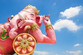 stock photo of ganesh  - Beautiful Ganesh statue on blue sky at wat saman temple in Prachinburi province of thailand Is highly respected by the people of Asia - JPG