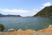 picture of dalyan  - Landscape of Koycegiz Lake coastline among mountains in Dalyan under clear sunny sky - JPG