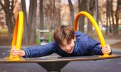picture of preteens  - preteen handsome boy play in outdoor gym training ground - JPG