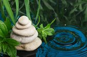 picture of rain  - Spa still life with stone pyramid reflecting in water under rain - JPG
