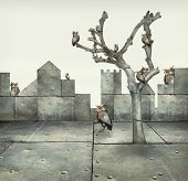 stock photo of surreal  - Surreal illustration of many small mechanical owls on a tree and scattered in a mechanic landscape - JPG