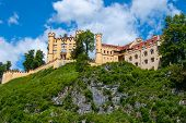 image of yellow castle  - yellow castle on a rocky hill with cloudy sky