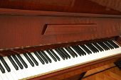 Classic Piano With The Polished Wooden Finishing poster