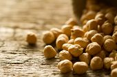 pic of chickpea  - scattered chickpeas from a jute bag on old wooden background  - JPG