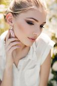 image of tied hair  - Young beautiful woman brunette hair is tied in her hair - JPG