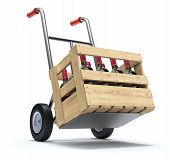 stock photo of hand truck  - Hand truck with wine bottles in a wooden crate  - JPG