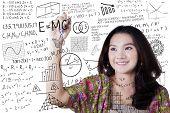 Постер, плакат: Girl Writes Math And Science Formula