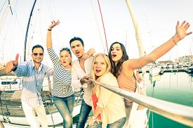 stock photo of selfie  - Best friends using selfie stick taking pic on exclusive luxury sailing boat  - JPG