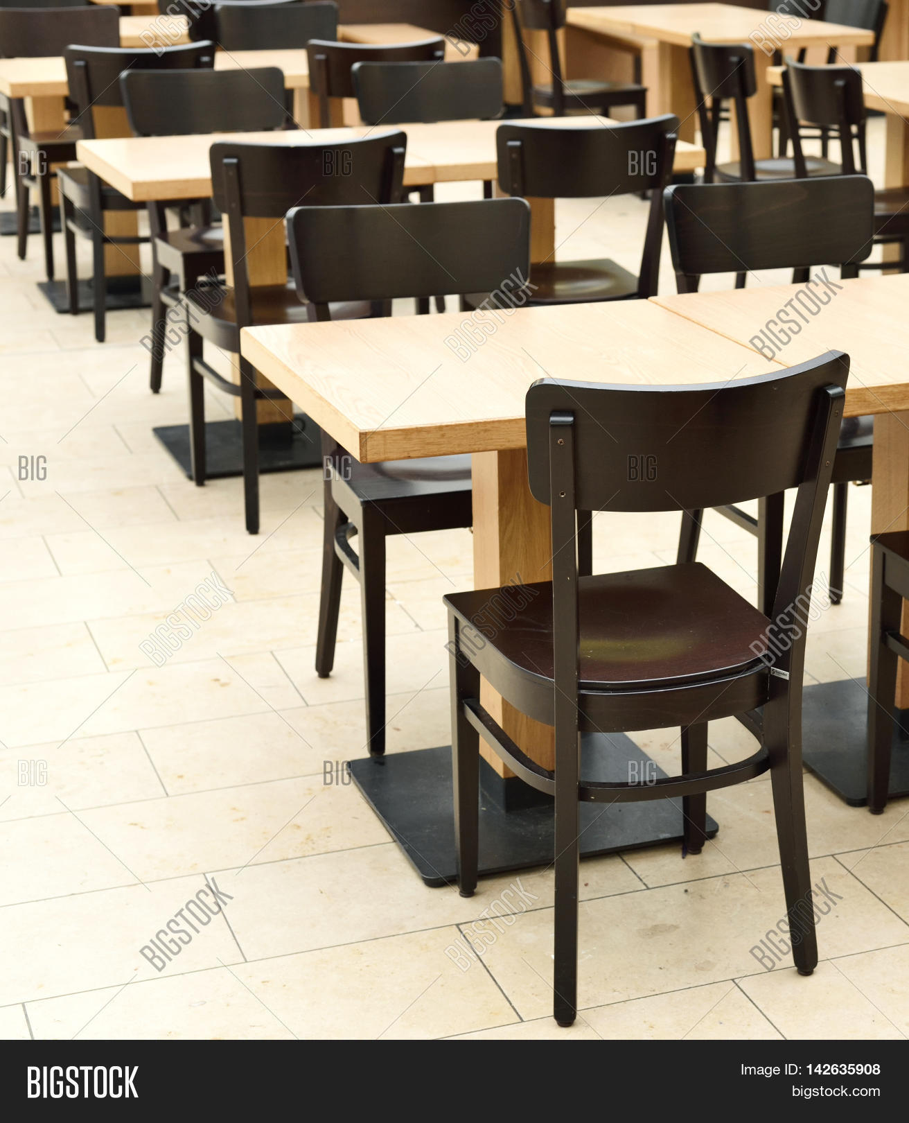 Restaurant furniture in an empty dining hall or restaurant for Dining hall furniture