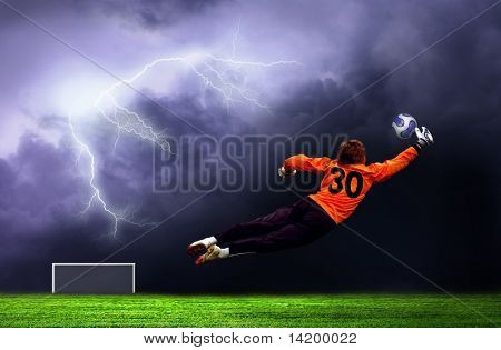 Football goalman on lightning sky