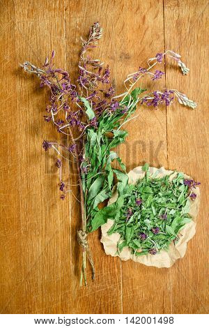 Fireweed.Dried herbs for use in alternative medicine.Herbal medicine phytotherapy medicinal herbs.For preparation of infusions decoctions tinctures powders ointments tea.Background wooden board