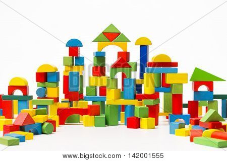 Toy Blocks, Wooden City Baby House Building Bricks over White Background