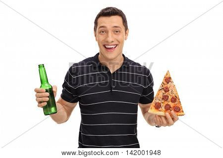 Smiling young guy holding a beer bottle in one hand and a slice of pizza in the other isolated on white background
