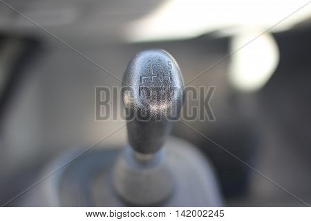 the shift lever in the cabin of the car