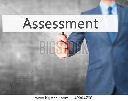 Assessment - Business Man Showing Sign